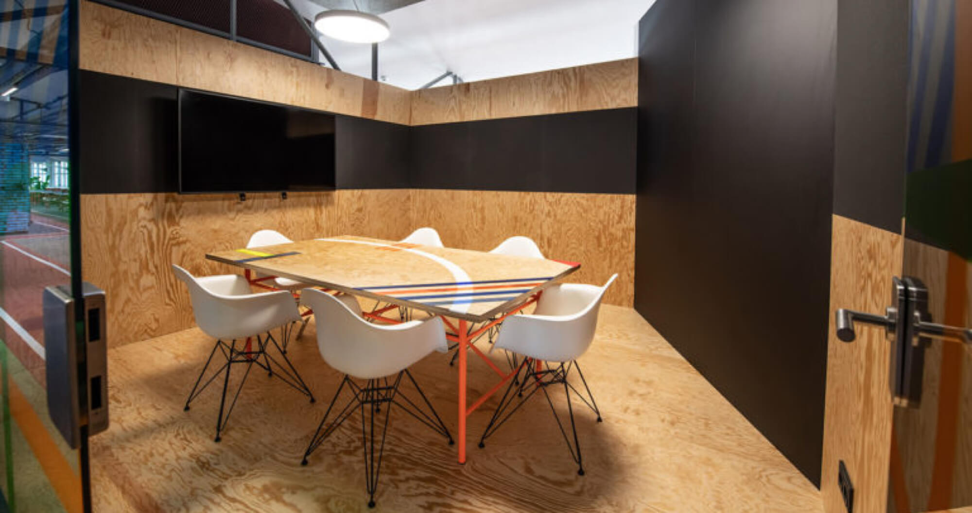 Meetingroom with wooden walls and floors