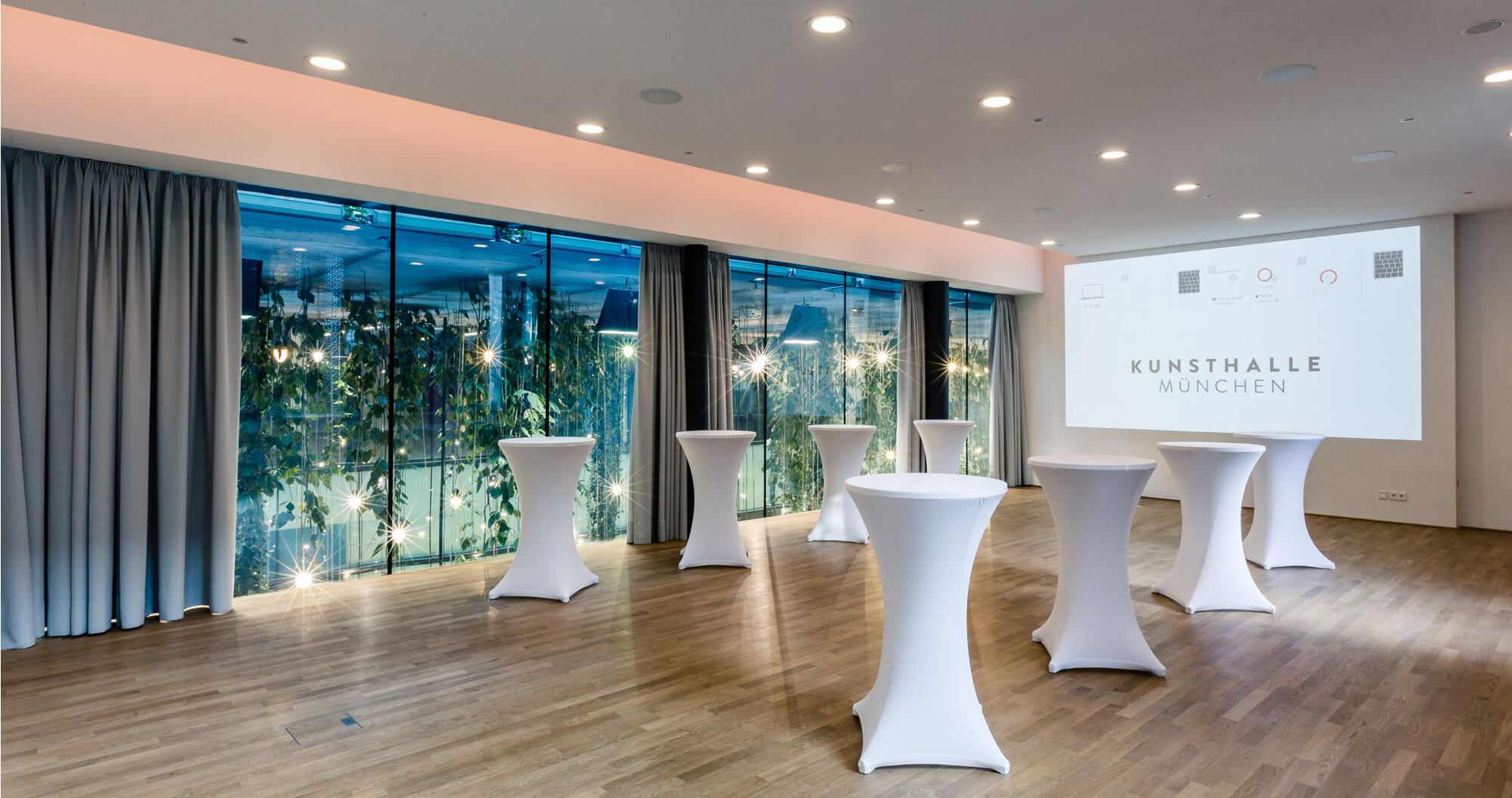 Presentation Room with a projector and high tables