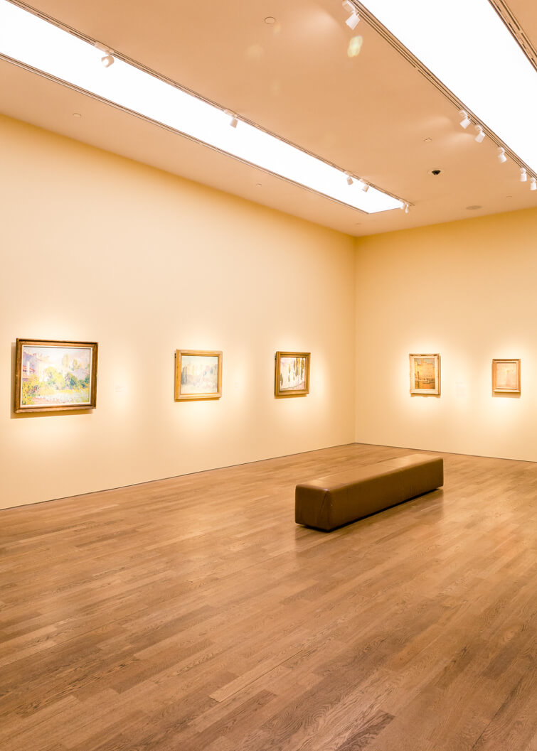 Bright and clean museum hall with images hanging on the walls