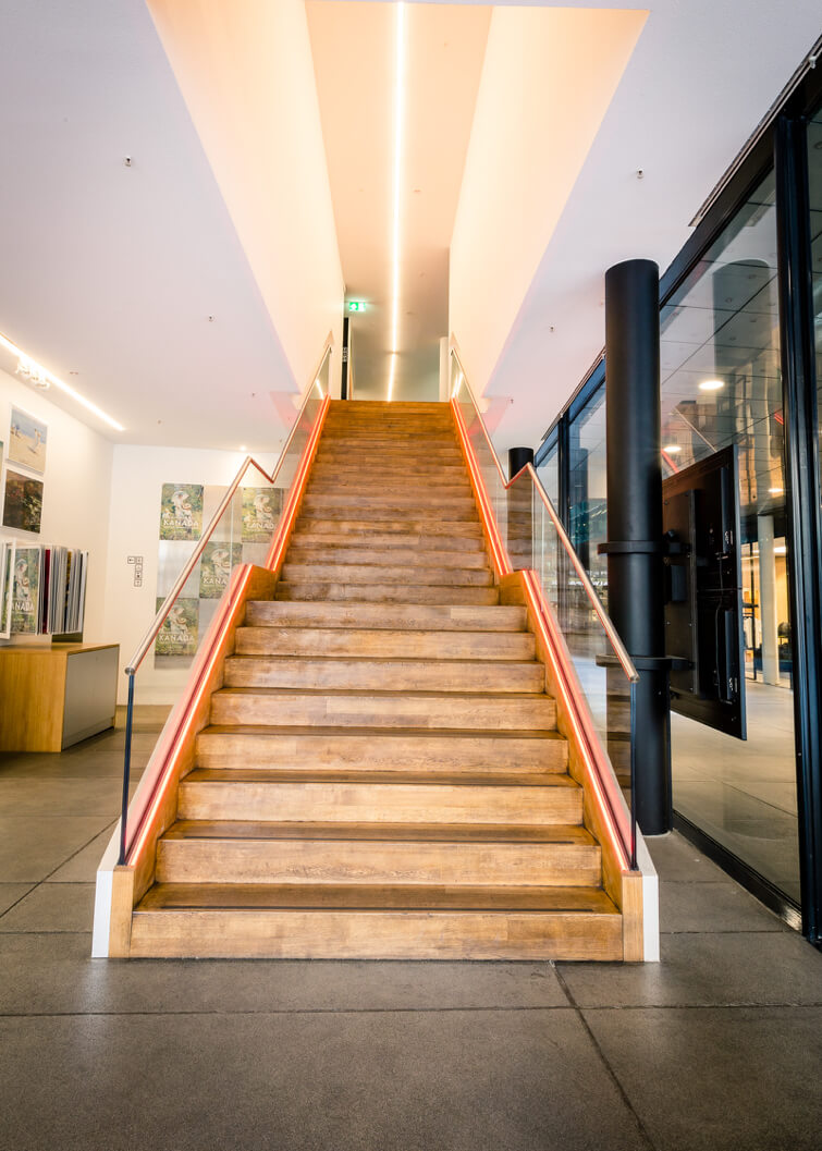 Wooden stairways with modern lighting