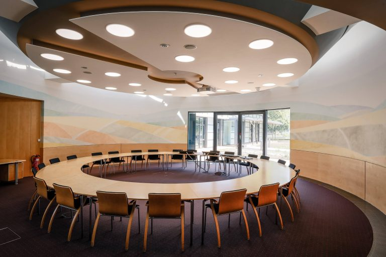 Meeting room with a big, round table in the middle